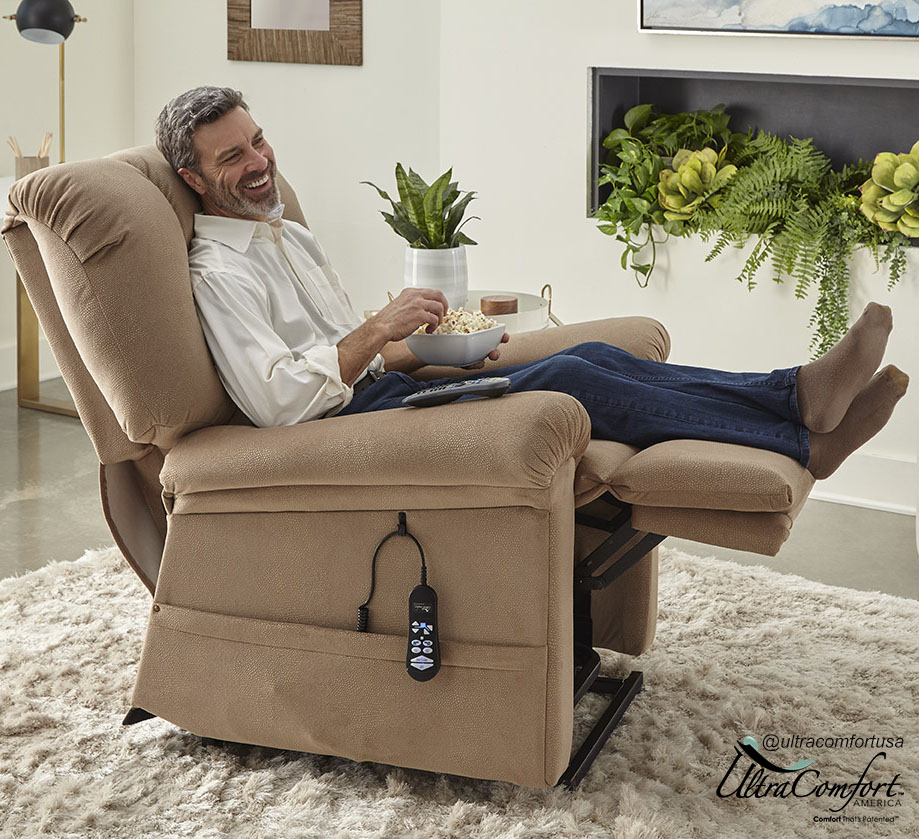 Man eating popcorn in an UltraComfort Power Lift Recliner